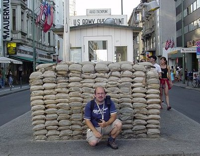 JC in front of Checkpoint Charlie